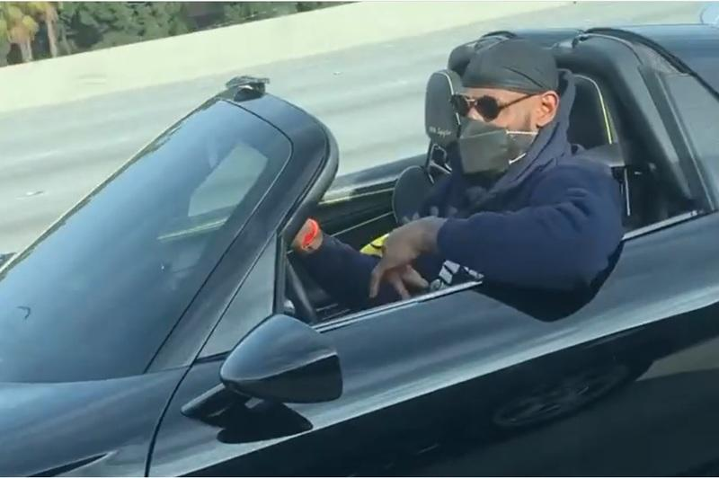 LeBron James Looks Good in a Porsche 918 Spyder, But He Can Barely Fit in It