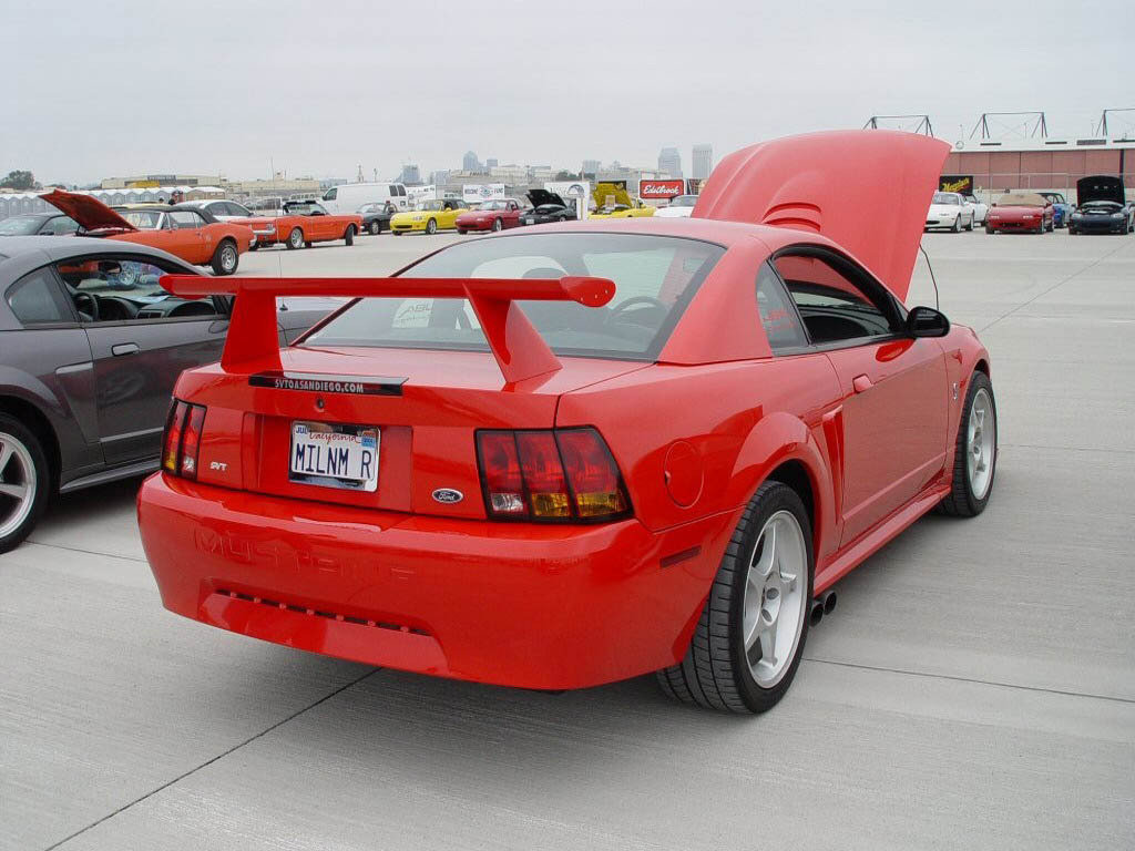 The 2000 ford svt mustang cobra r wearing its production performance red paint was displayed for the first time at the specialty equipment market