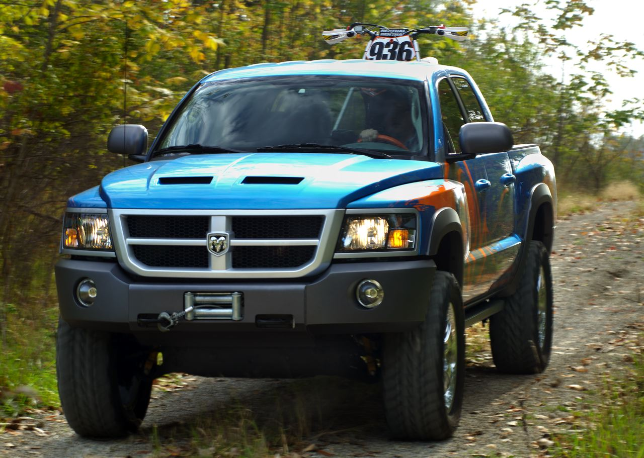 The dodge dakota mx warrior is a design exercise intended for the younger action sports crowd this authentic motocross themed concept is a cooperative