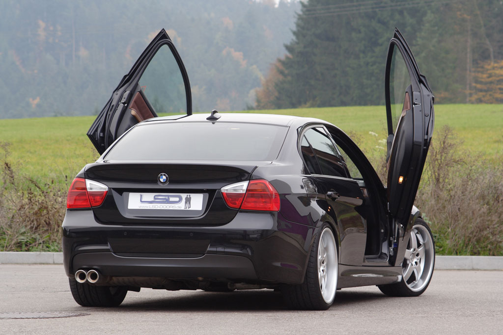 By mounting LSD wing door hinges the quite unadventurous BMW 3 Series E90-saloon becomes a real showcar. The wing doors hinges are available with immediate ... & BMW 3 Series E90 With LSD Doors News - Top Speed