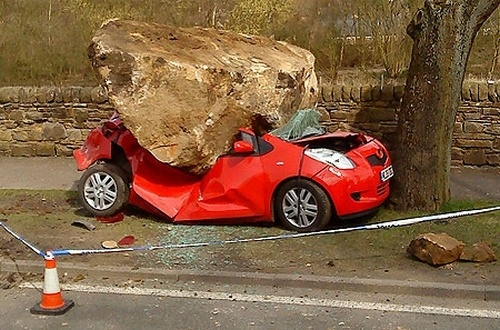 Unsuspecting Toyota Yaris gets flattened by giant boulder