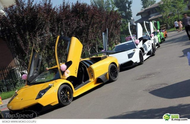 Auto entourage in wedding features 12 Lamborghinis and two Rolls Royce Phantoms wallpaper image