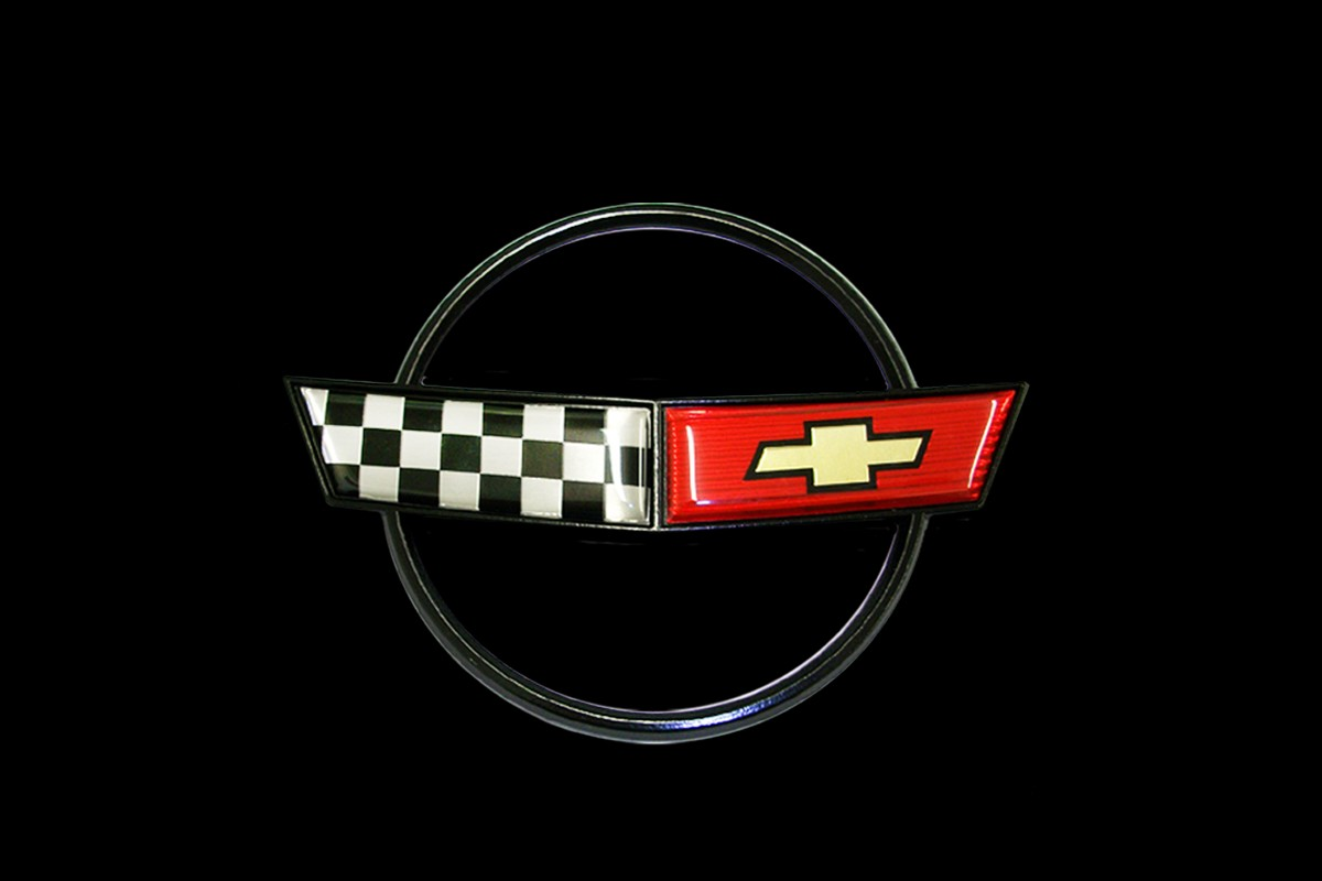 Evolution Of The Corvette And The Crossed Flags Logo Top Speed
