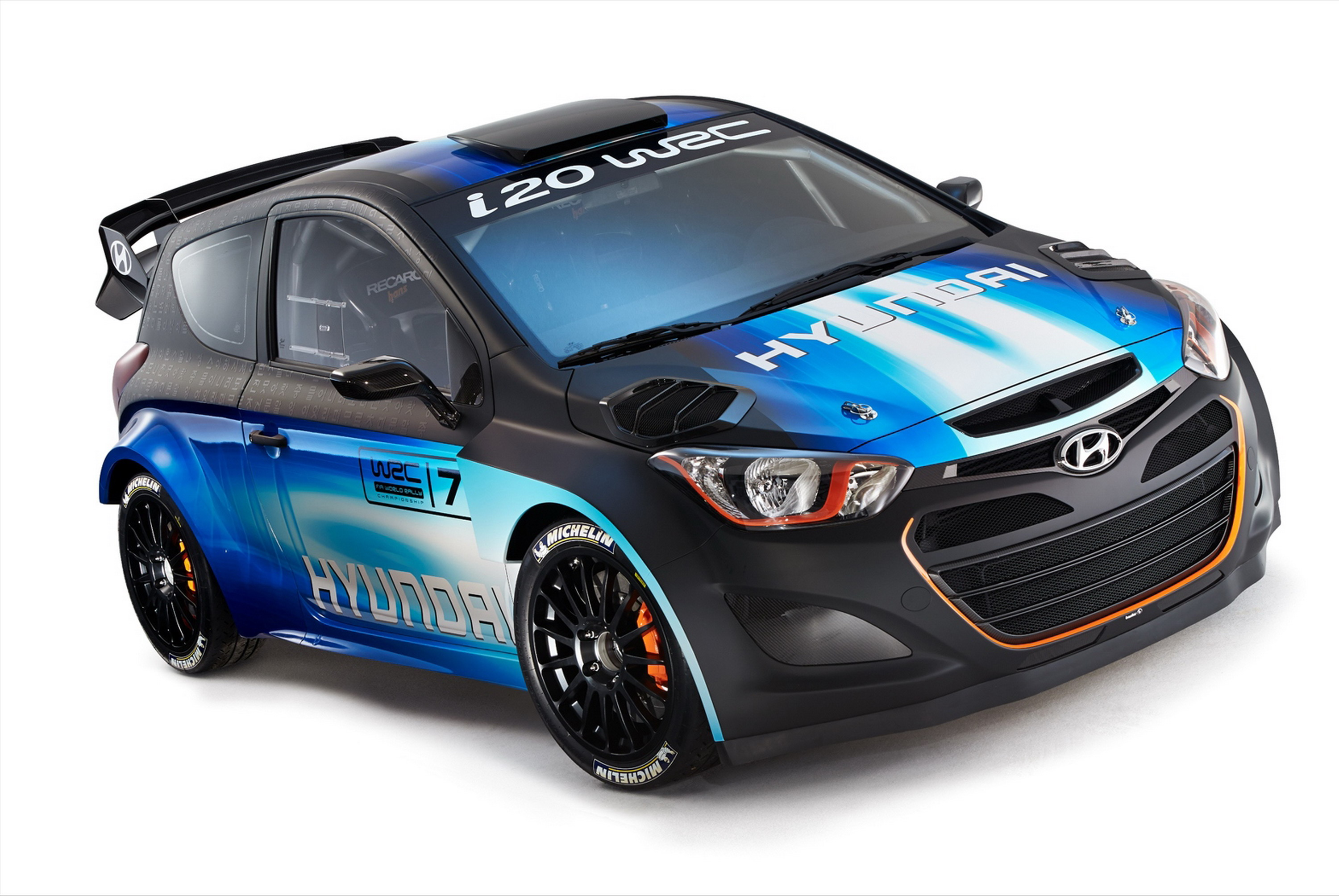 Hyundai has unveiled at the 2013 geneva motor show an updated version of its i20 wrc racecar set to be used in the fia world rally championship in the 2014