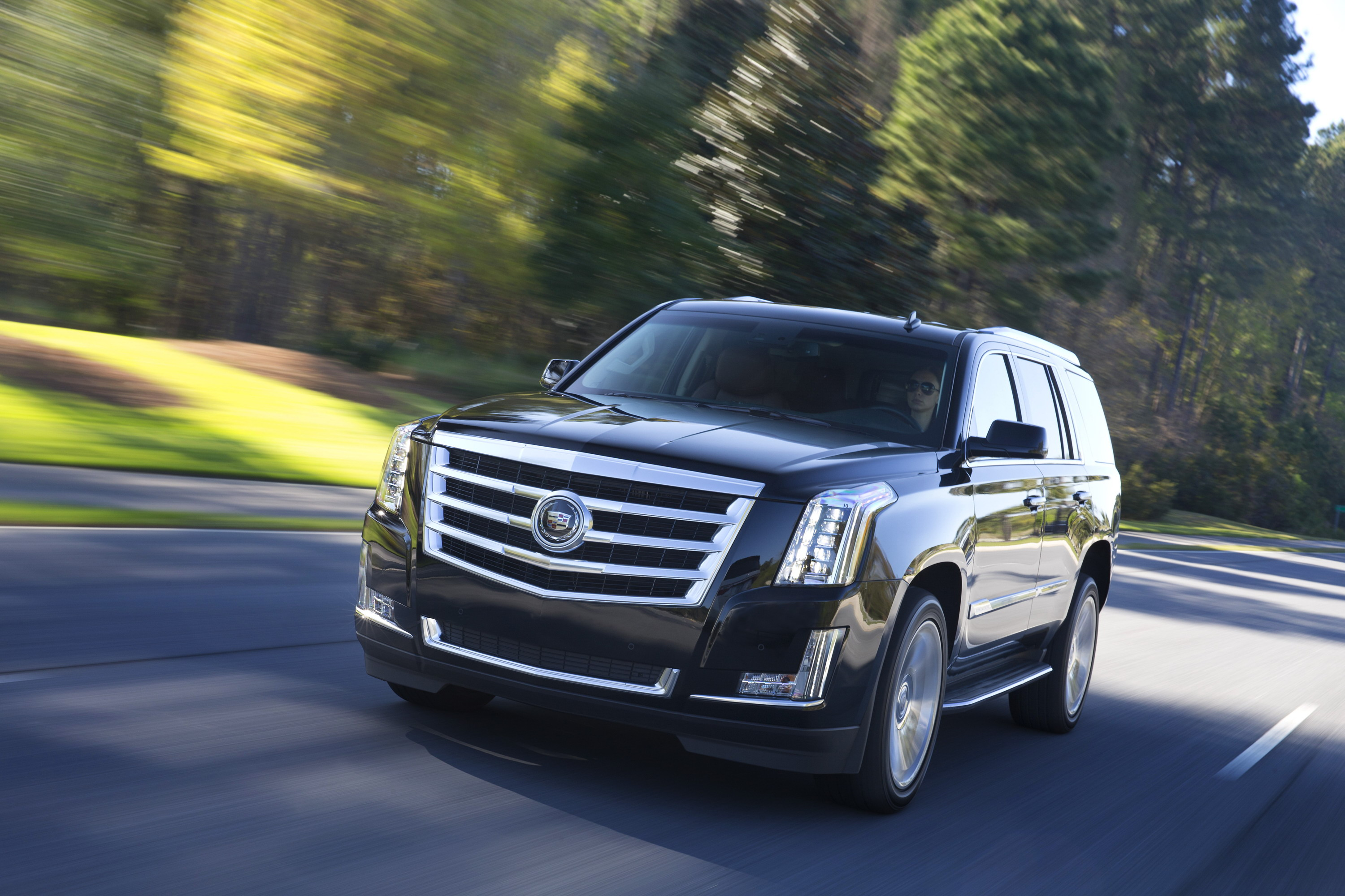 better and which escalade platinum esv money compared cadillac combo navigator cars story lincoln is