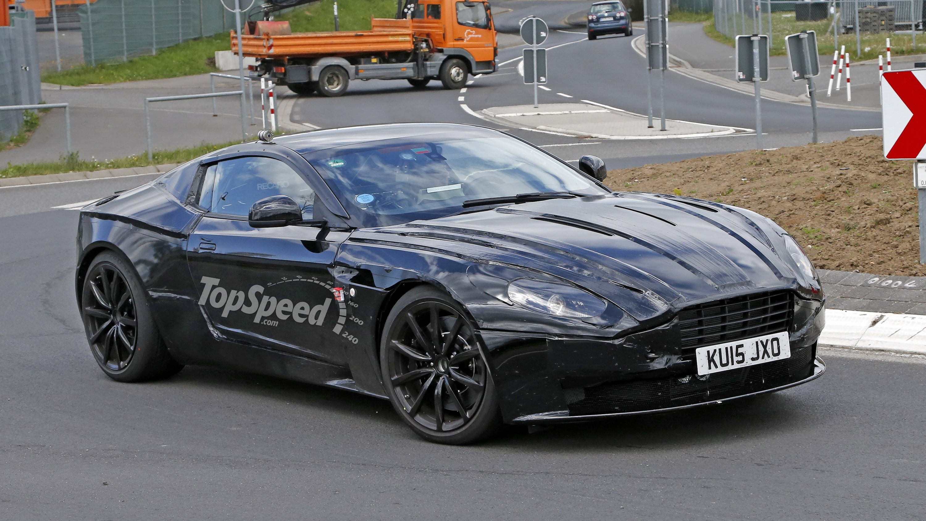 aston martin db11 looks even better in black spy shots pictures photos wallpapers top speed. Black Bedroom Furniture Sets. Home Design Ideas