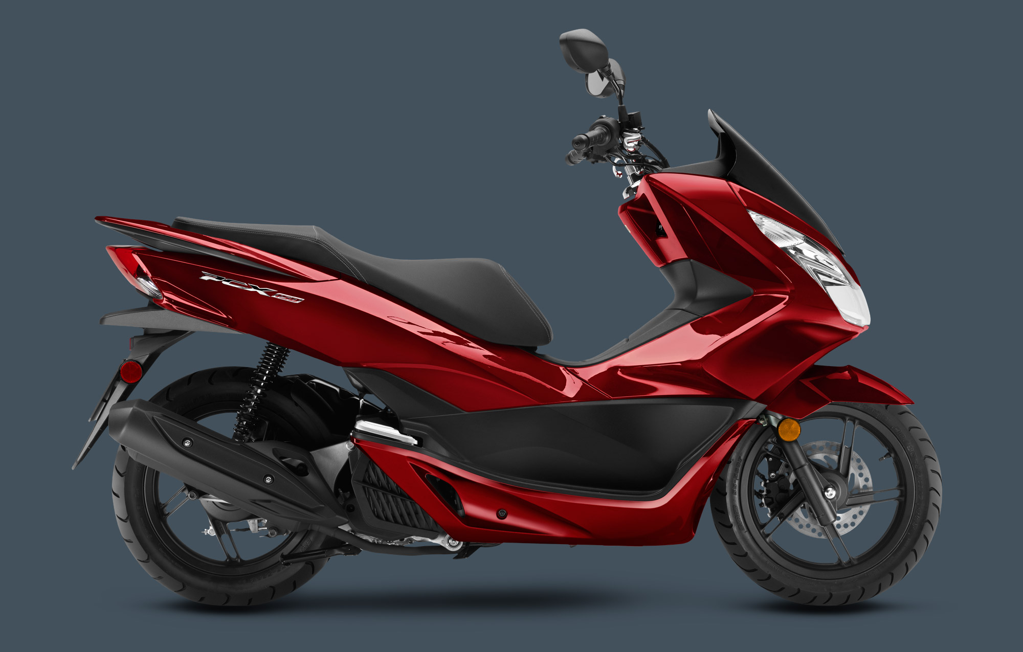 we hybrid other lower of features honda for a designed us mini climate and compared scooter given goes may world them greener the current in featureshonda gas pcx cleaner to most markets cost electric see not