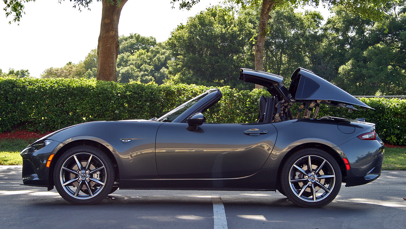 here 39 s how the mazda miata 39 s retractable hardtop works. Black Bedroom Furniture Sets. Home Design Ideas